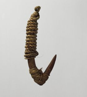 Two-part fishhook made of wood, with twisted cord, and lashing made of plant material.