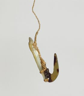 Fishhook with mother-of-pearl shank, the hook made of tortoiseshell, both secured together with plaited cord of plant fibre to form the line.