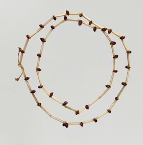 Necklace made from bird bones and small snail shells.