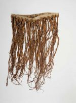 of apron made of red-brown dyed musa leaves, knotted to a plaited band.