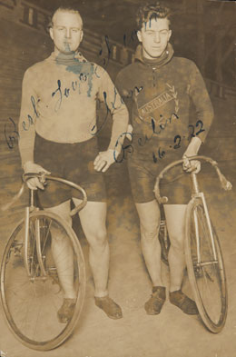 Will Spencer and Ken Ross standing beside their bicyclies