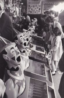 The laughing clowns section of the Royal Adelaide Show.  Woman and children are playing the games.