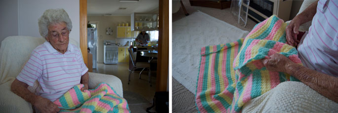 An elderly lady with a crochet blanket.
