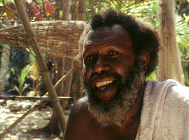 Colour portrait photo of a smiling Eddie Mabo.