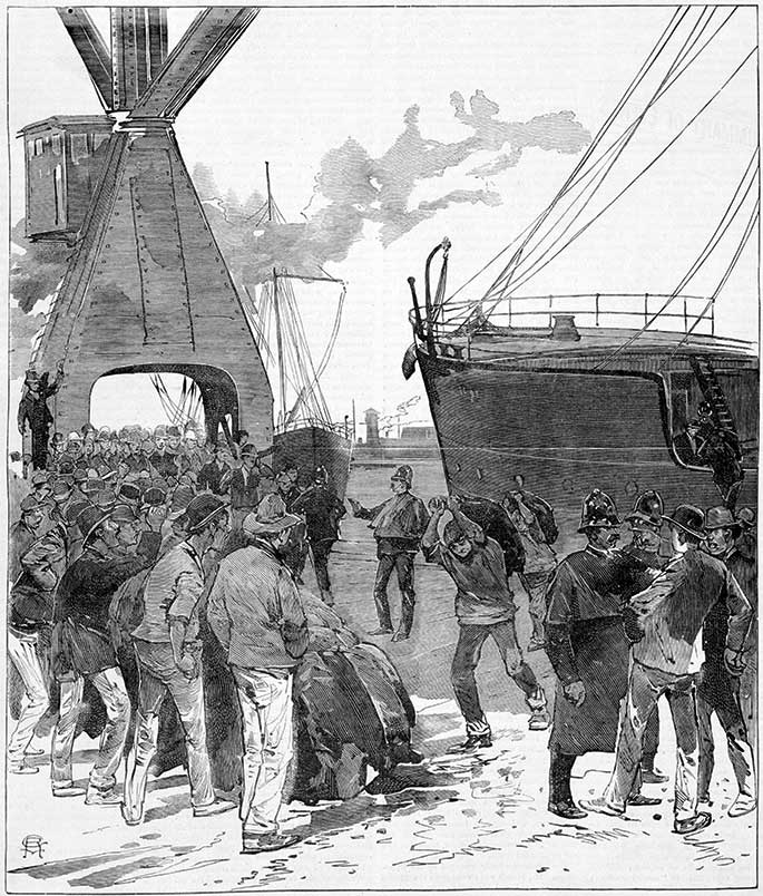 A handful of men carrying sacks from a moored ship surrounded by large numbers of jeering men kept at bay by a handful of police.