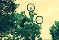 Young man on bicycle in air