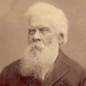 studio photographic portrait of older man, with white hair and long white beard