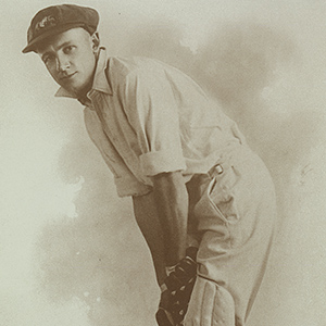 Autographed photo of Don Bradman posing with cricket bat in 1928.