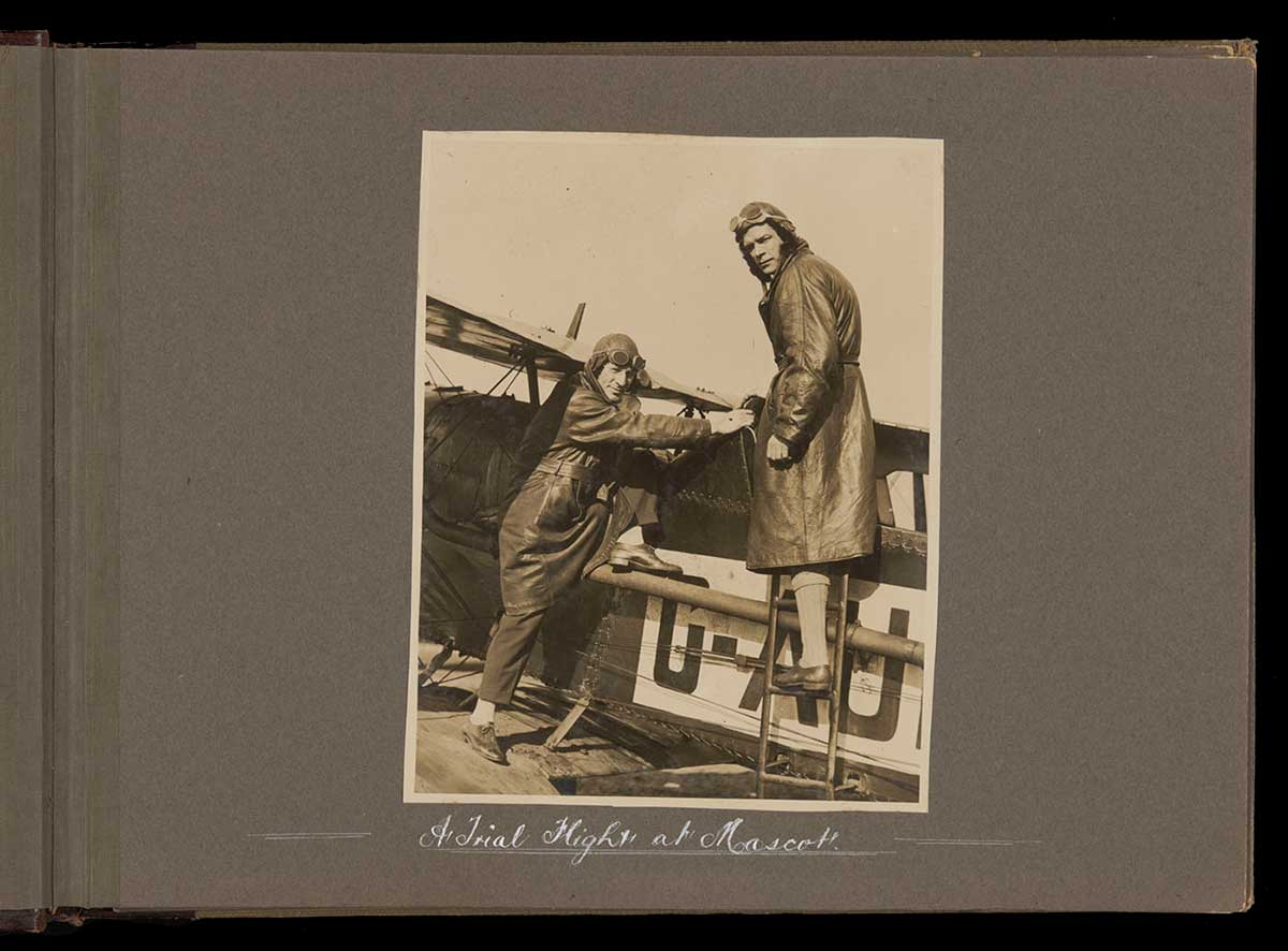 Kingsford Smith and Ulm about to climb aboard their plane. - click to view larger image