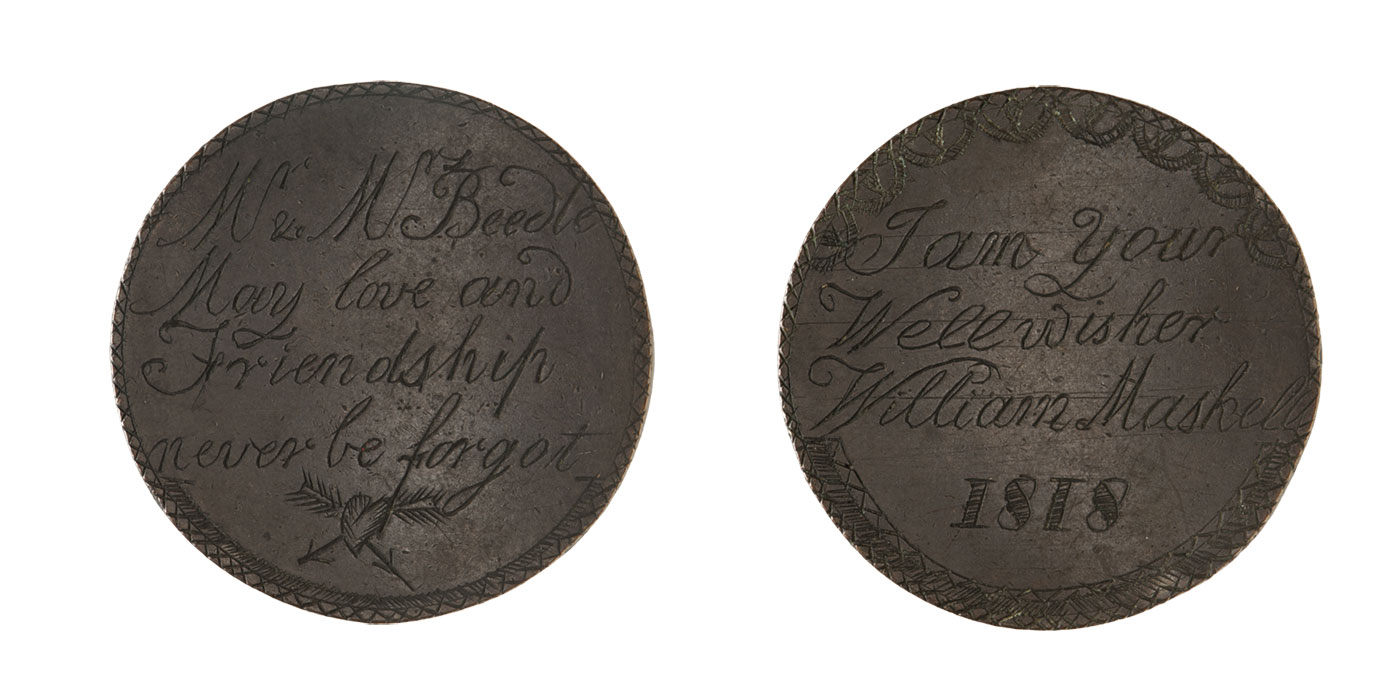 Token engraved with a fine crisscross border, and a heart crossed with arrows at the base of cursive text: Mr & Mrs Beedle, May love and Friendship never be forgot.