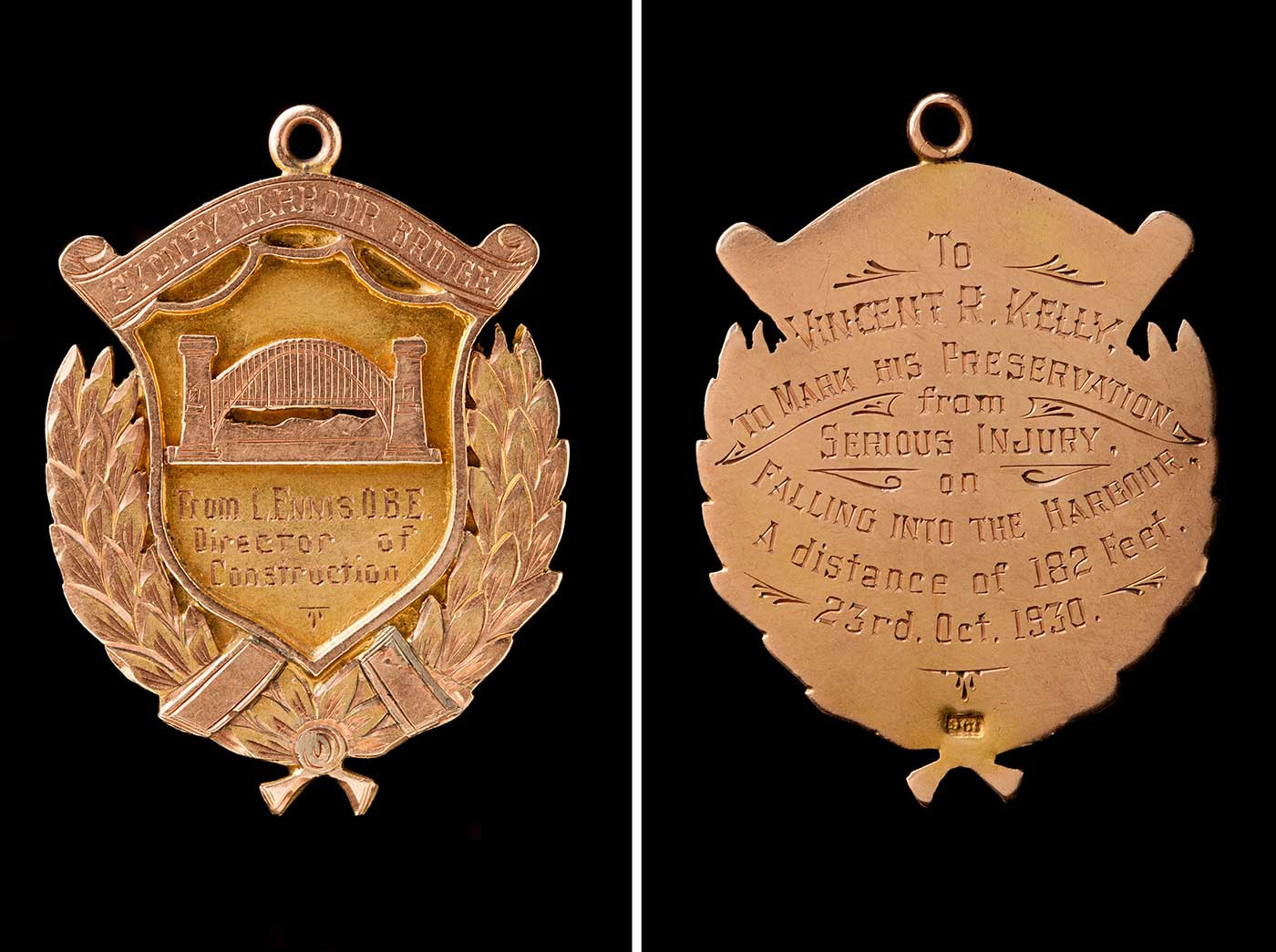 The front and back of a medal awarded to Vince Kelly.  The front has an image of the Sydney Harbour Bridge with an inscription that reads: 'From L. Ennis. O.B.E. Director of Construction'. The inscription on the back reads: 'To Vincent R. Kelly. To mark his preservation from serious injury on falling into the harbour. A distance of 182 feet. 23rd. Oct. 1930.' - click to view larger image