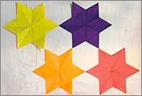 paper stars; yellow, purple, orange and dusty pink