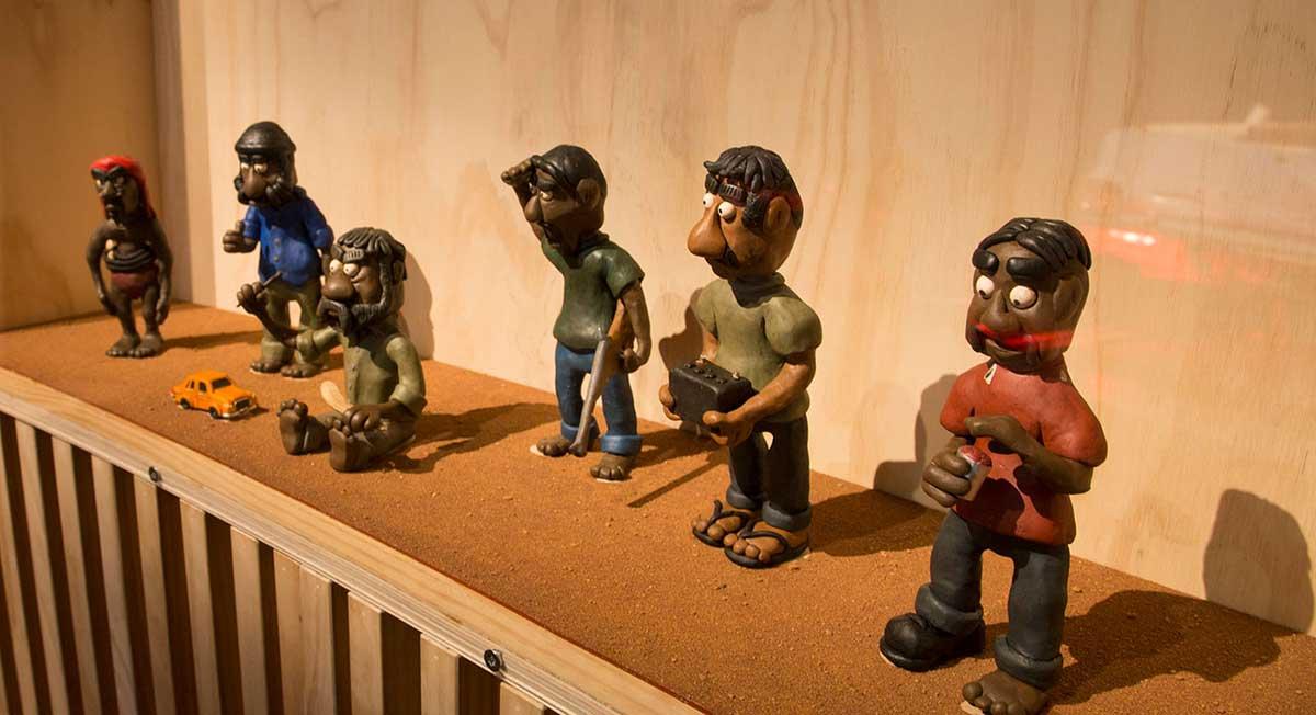Six plasticine figures depicting Aboriginal men. - click to view larger image