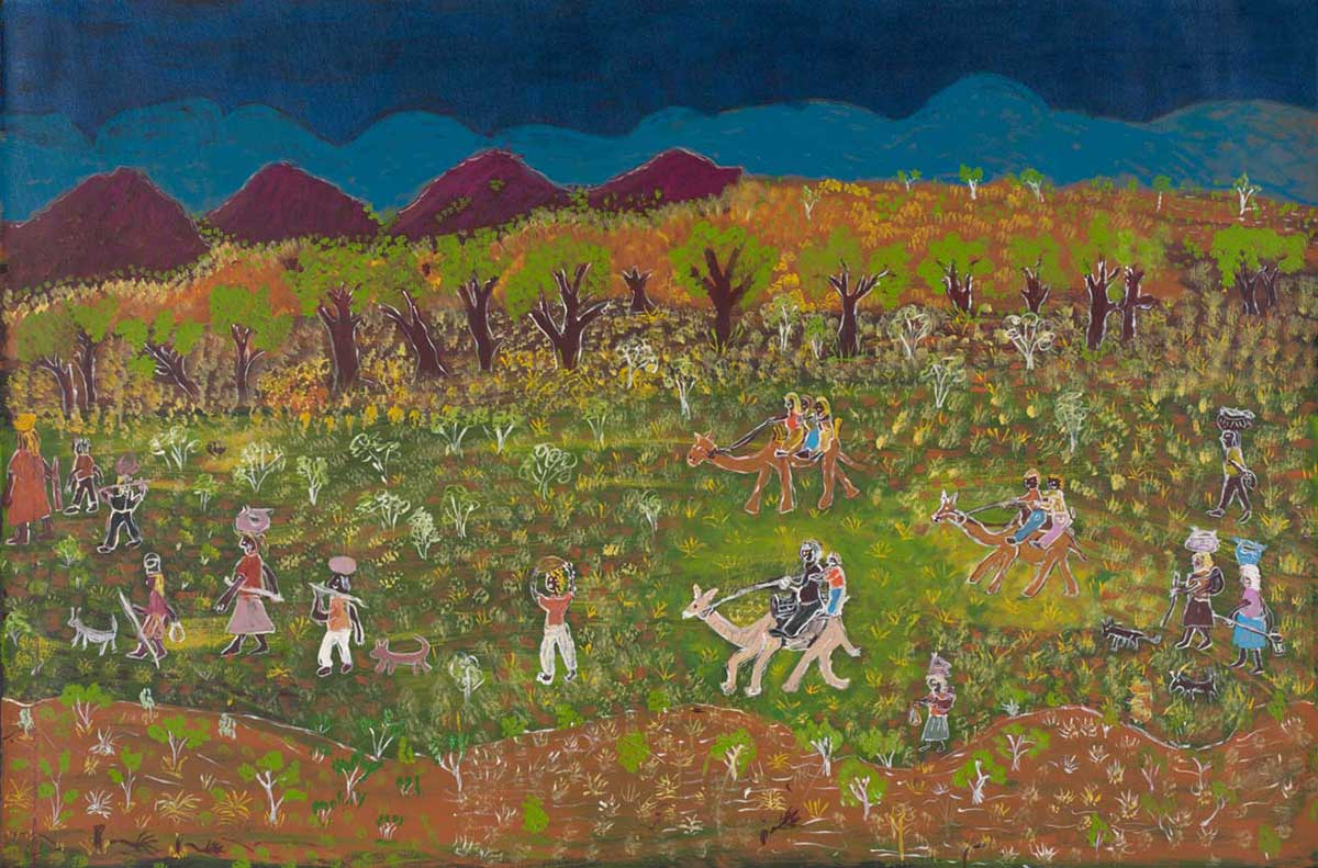 A painting depicting a landscape with trees and purple hills in the background against a sky painted in two shades of blue . In the foreground there is a group of figures and small animals moving across the landscape including two figures on each of three camels. Many of the figures are carrying belongings on their heads.  - click to view larger image