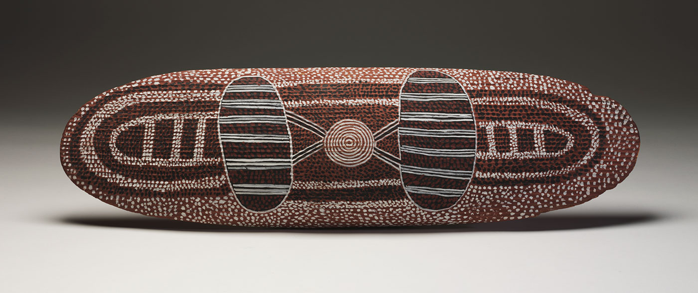 Man Dreaming shield 1972 by Anatjari (Yanyatjarri) Tjakamarra. - click to view larger image