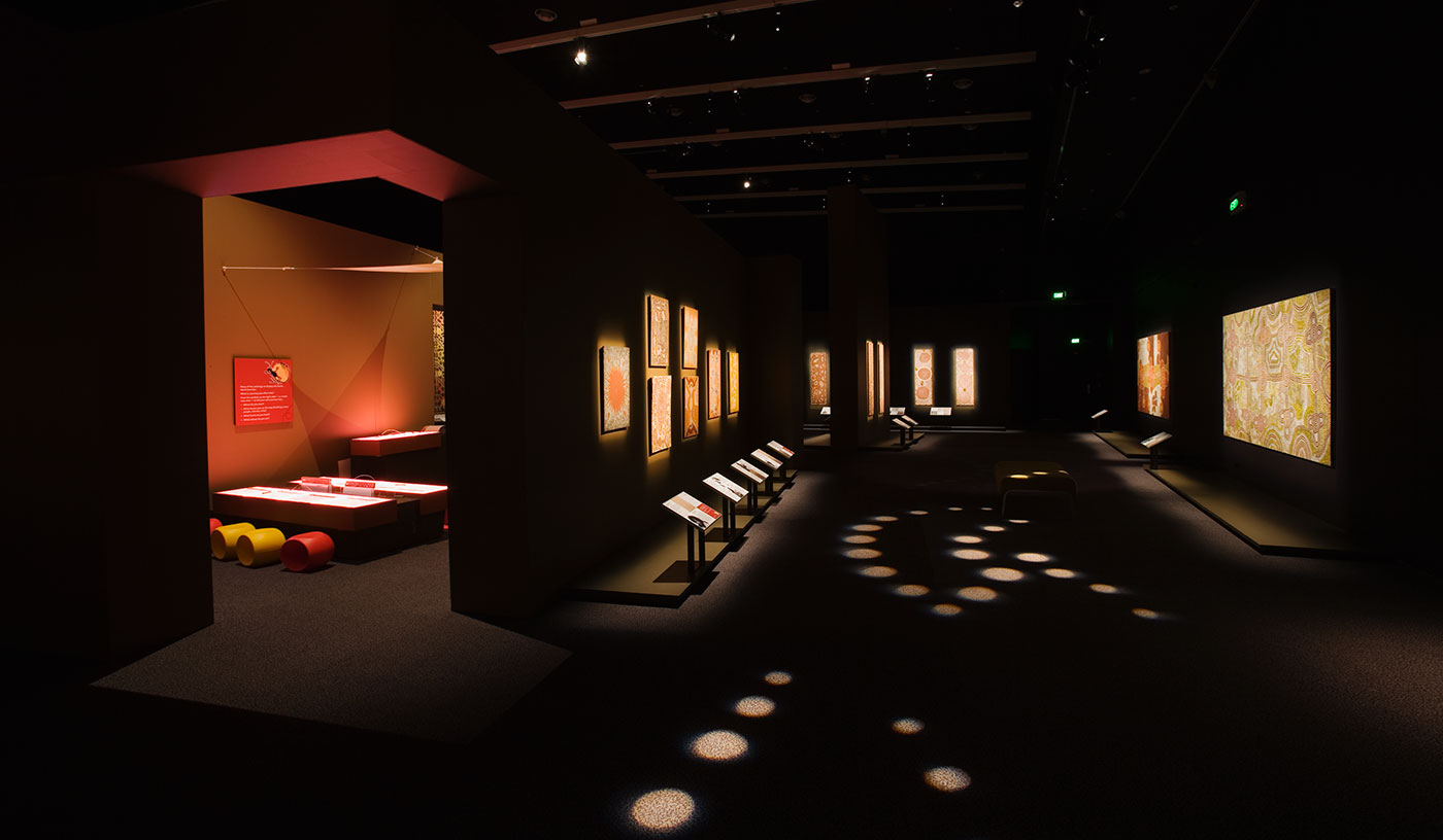 Tjitji children's activity space and various Papunya paintings in the gallery space. - click to view larger image