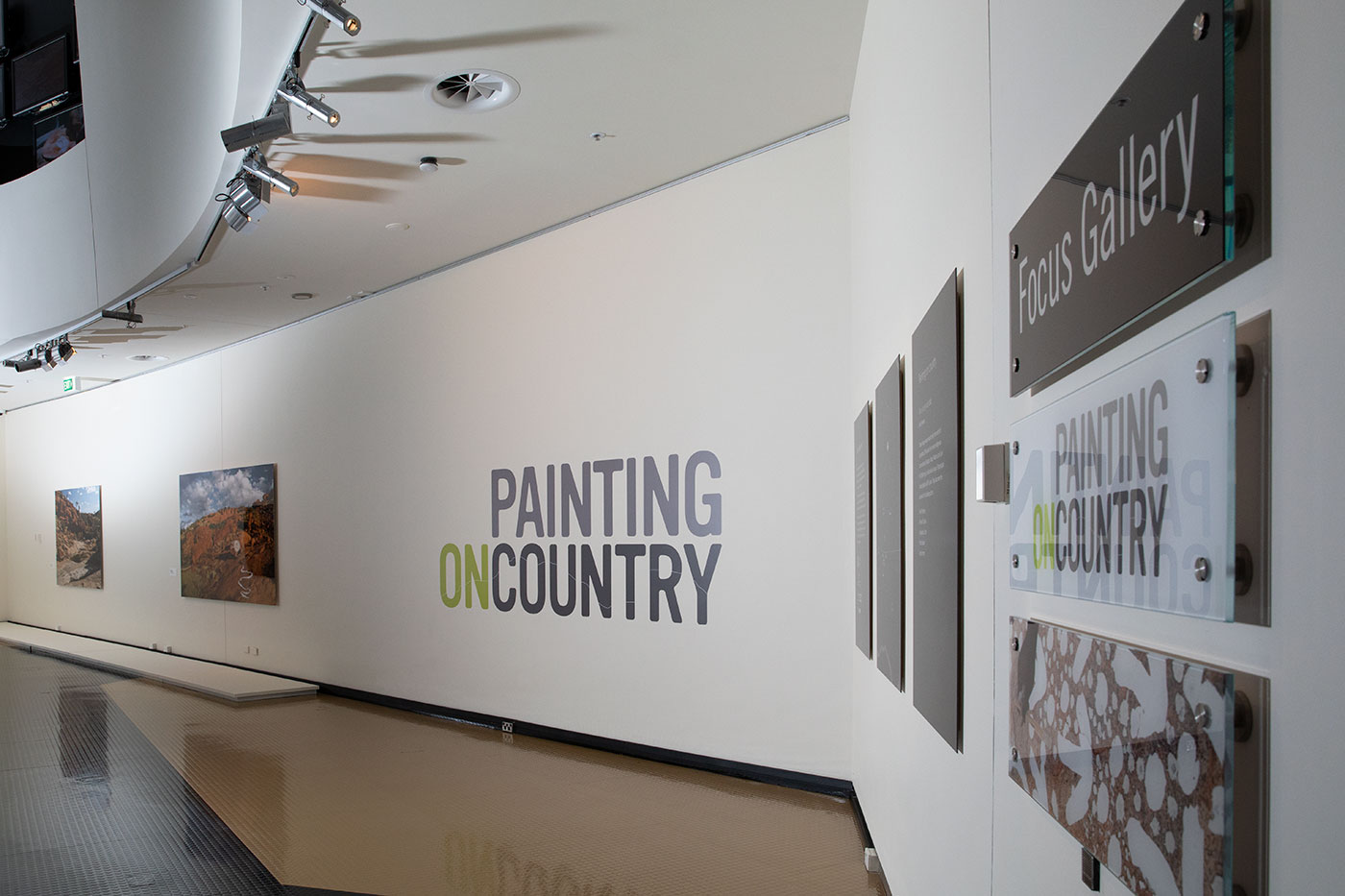 Photographs on display in the Painting on Country exhibition. - click to view larger image