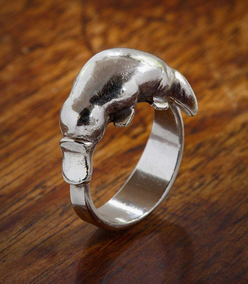Silver ring featuring a platypus design. - click to view larger image