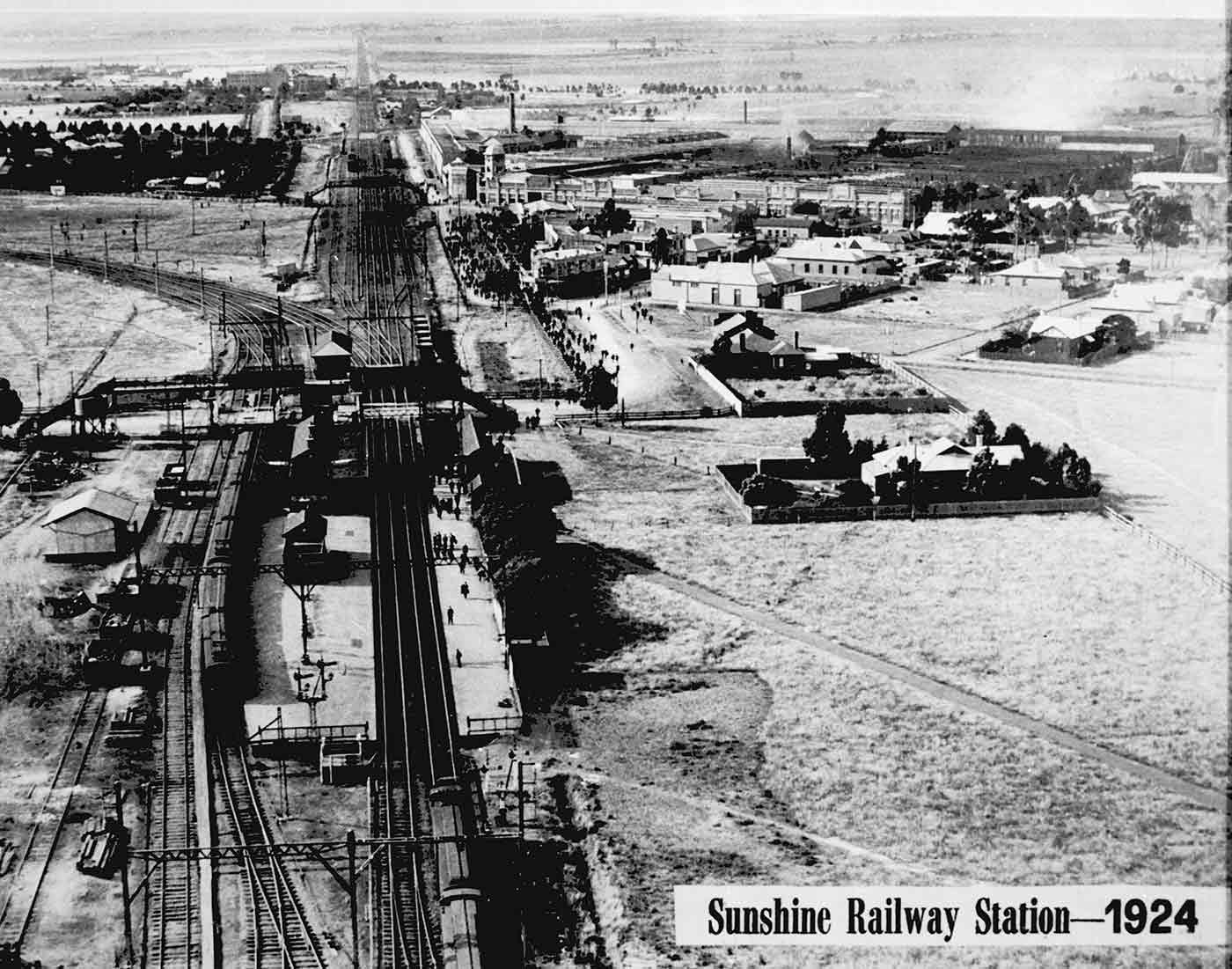 A black and white photograph of Sunshine railway station.