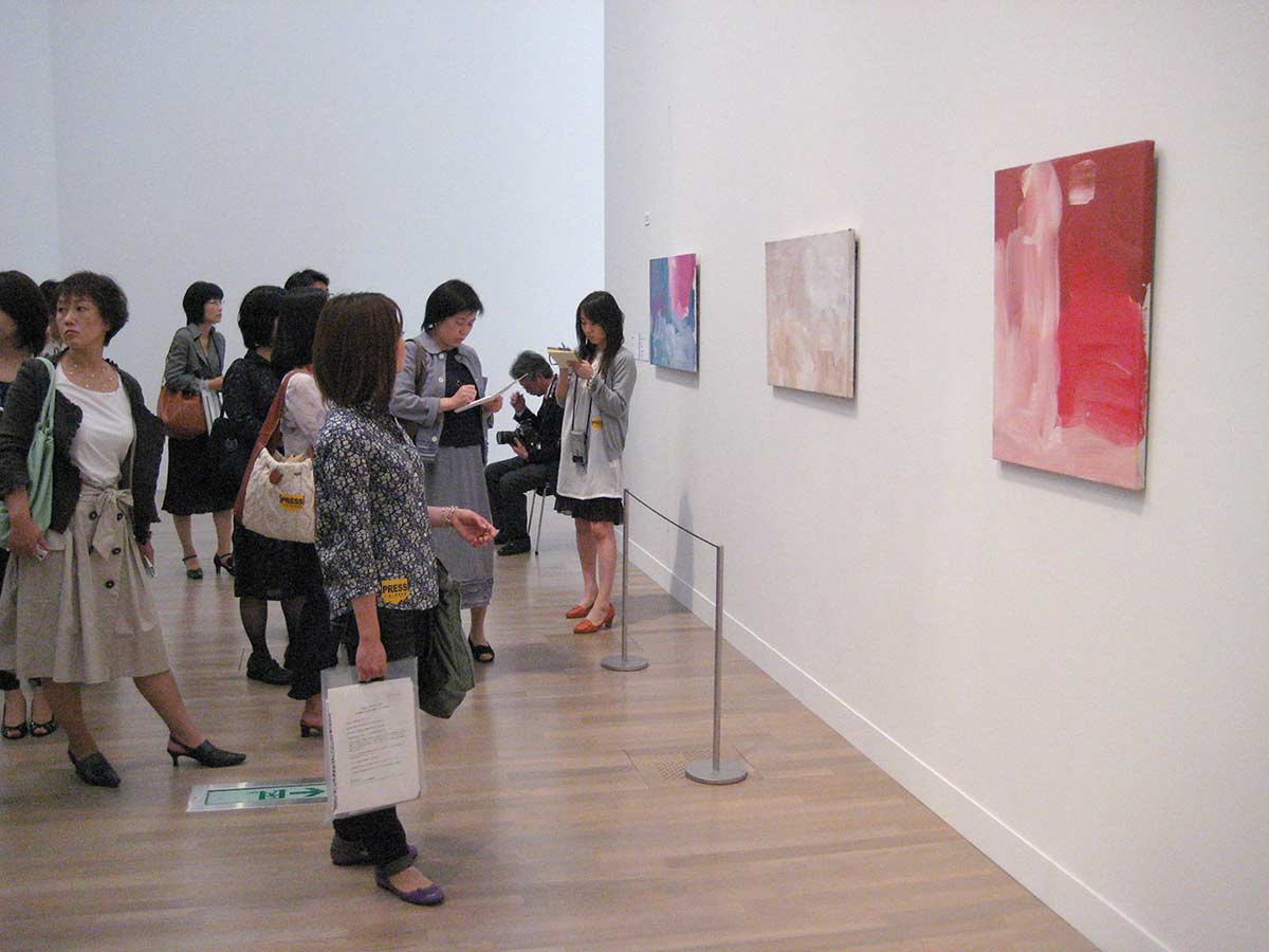 Japanese visitors viewing art work. - click to view larger image