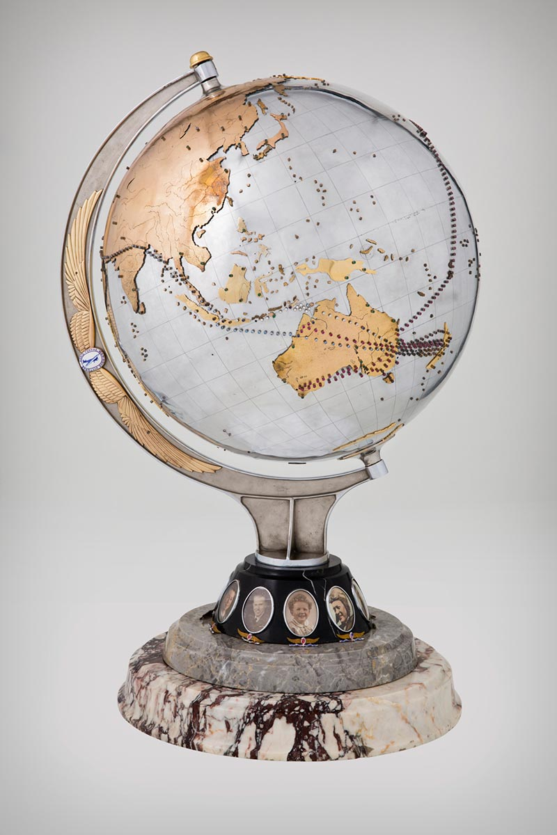 Metal globe studded with coloured stones marking the flight paths of Charles Kingsford Smith's plane the 'Southern Cross', - click to view larger image