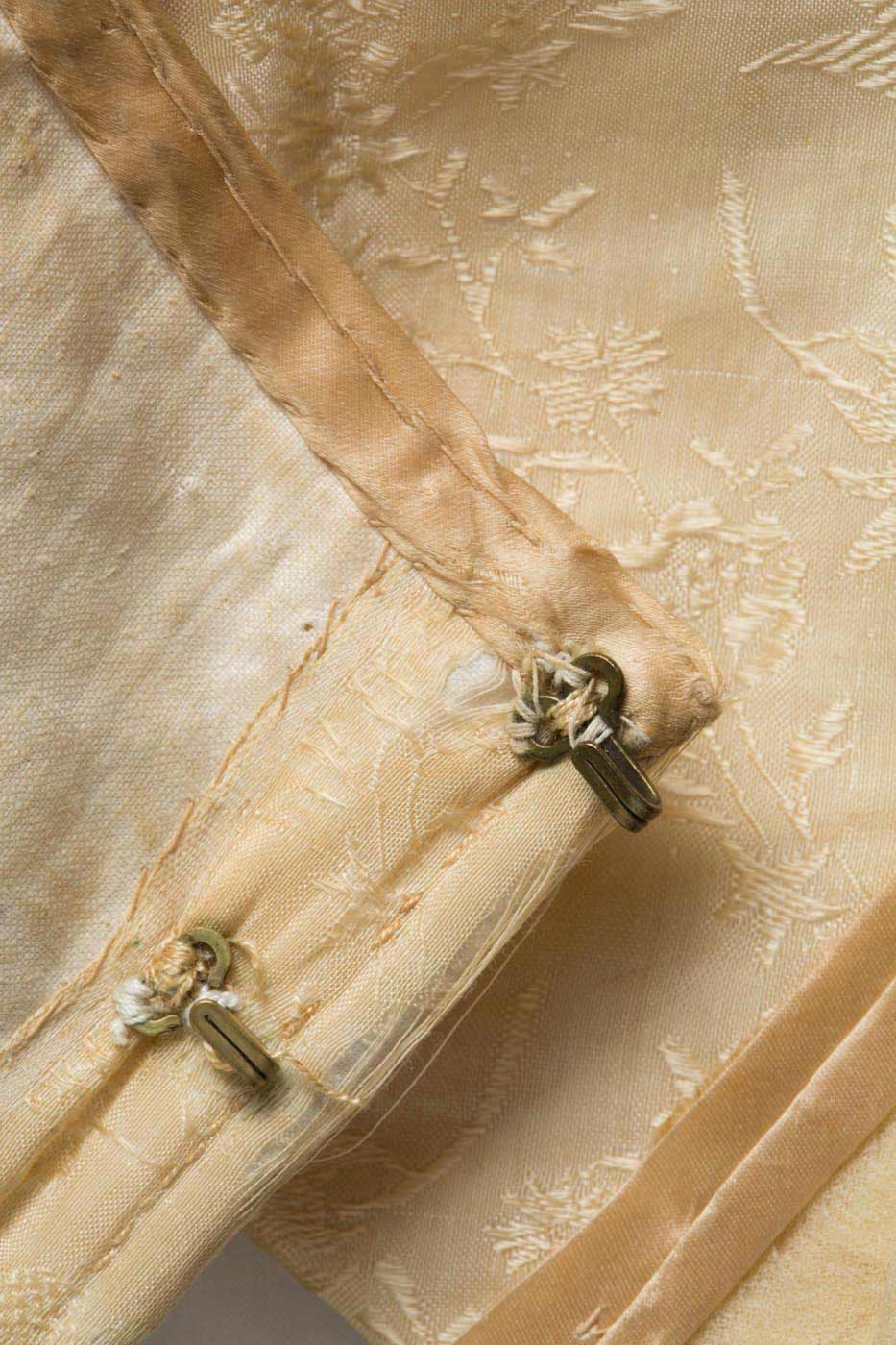 Detail of hook and eye closures used to fasten the bodice. - click to view larger image