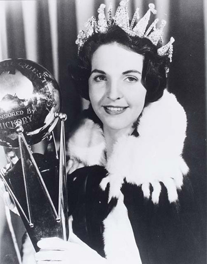 Miss Australia 1957, Helen Wood holding the Miss Australia trophy wearing the crown, robe and white gloves - click to view larger image