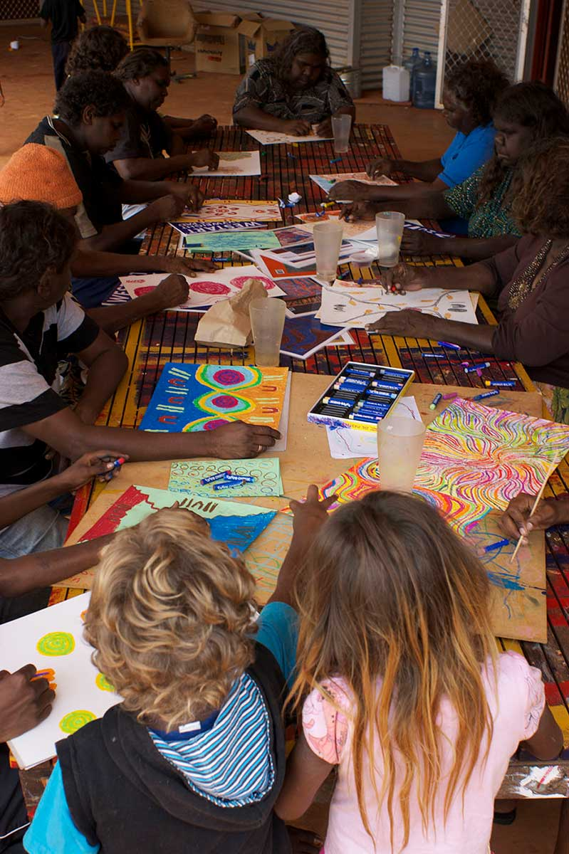A group of people participating in an drawing workshop. - click to view larger image