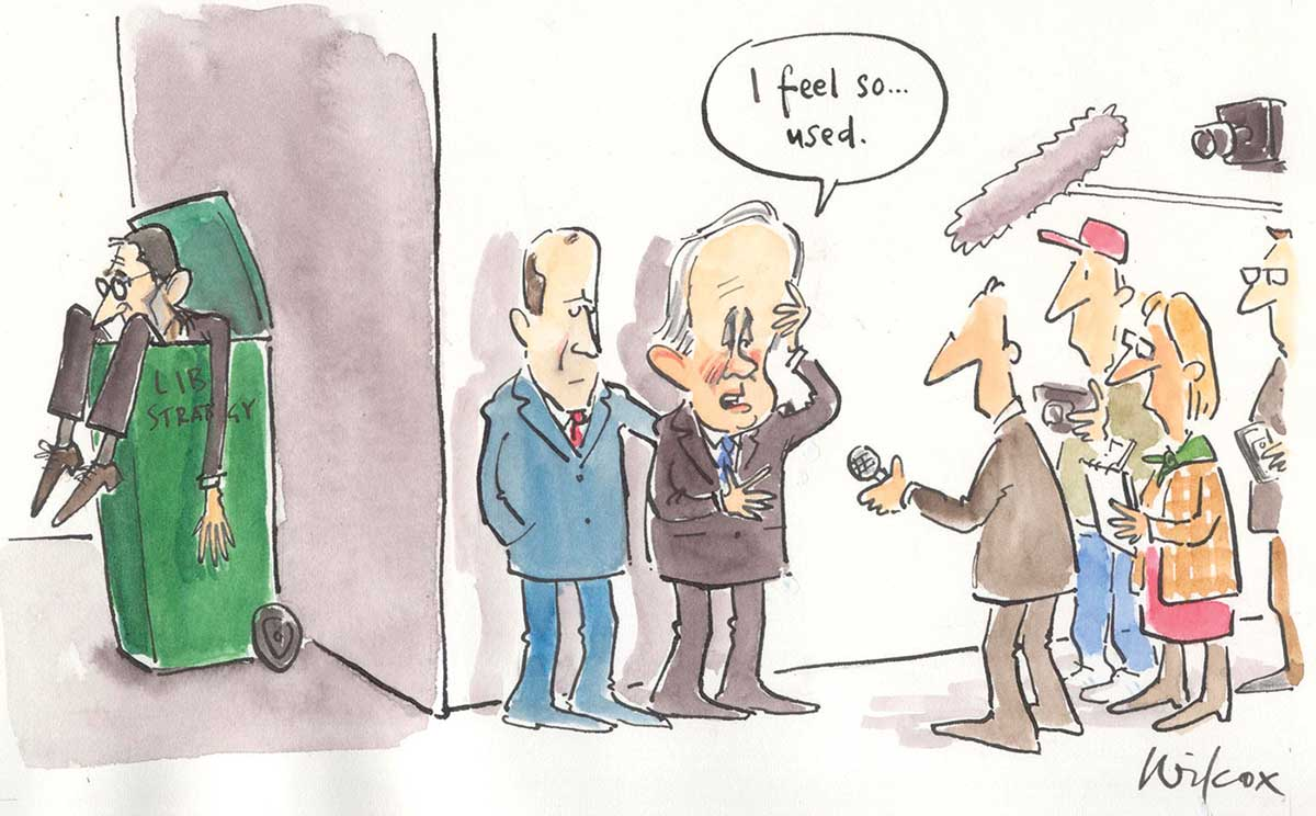 A colour cartoon of Malcolm Turnbull facing the press. In the background, Godwin Grech can be seen spilling out of a green wheelie bin, with the words 'Lib strategy' faintly visible on its side. Four journalists are in front of Mr Turnbull, microphones and cameras pointing. Mr Turnbull stands against a wall, with a man at his side with his arm behind Mr Turnbull offering support. With his hand at his brow as if massaging his temple to relieve a headache, Mr Turnbull says 'I feel so used'. - click to view larger image