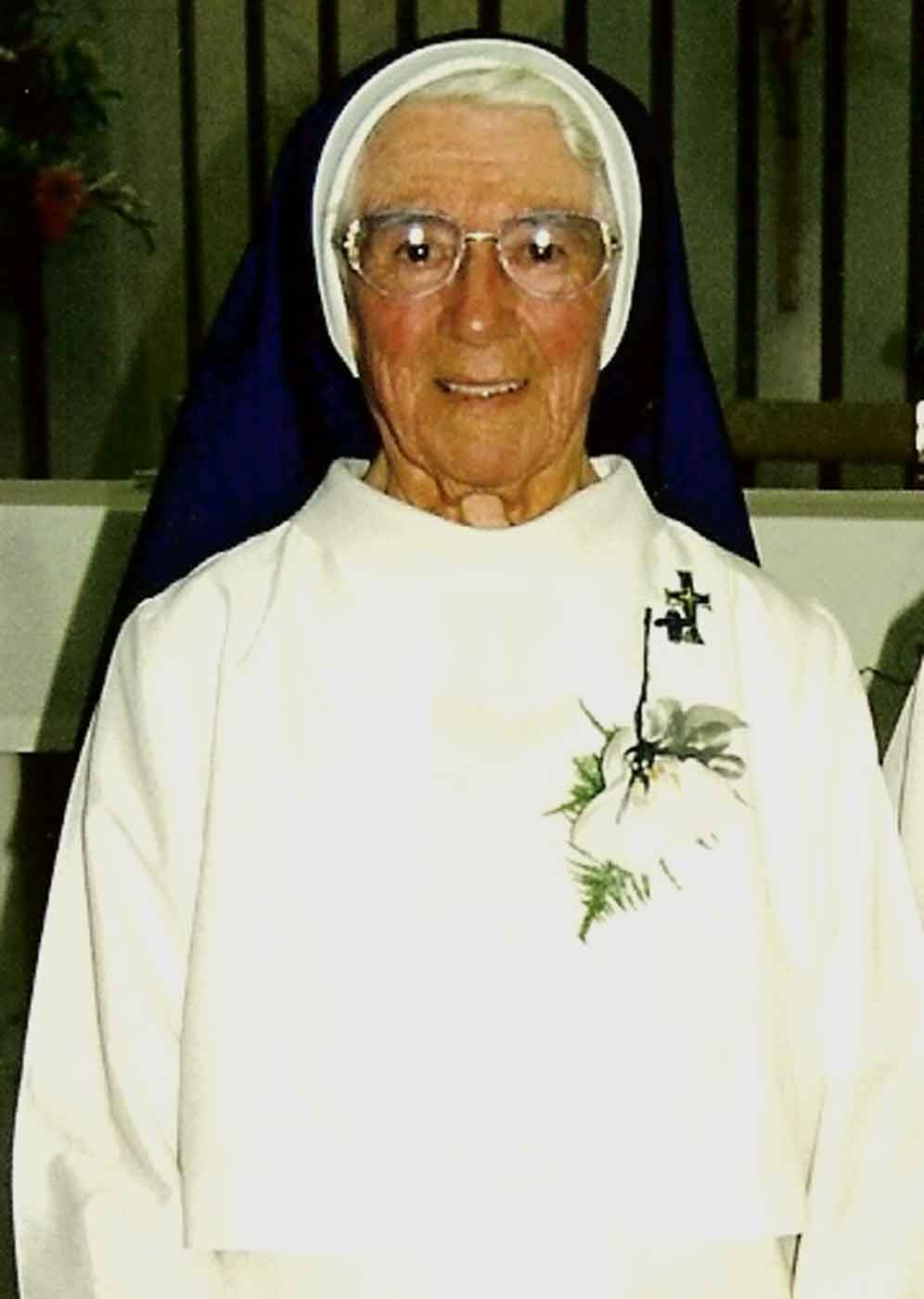 Photo portrait of a nun wearing habit. - click to view larger image