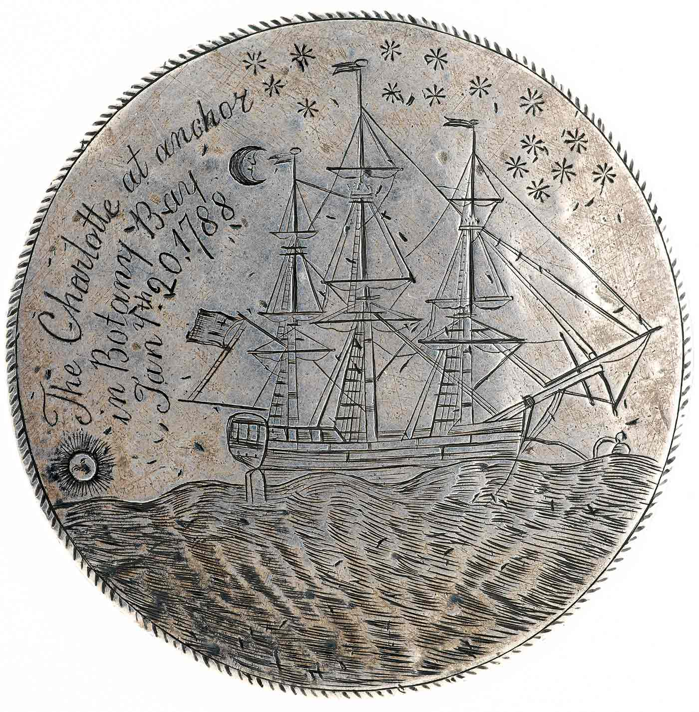Front view of a silver medal with inscription of text and a ship at sea. - click to view larger image