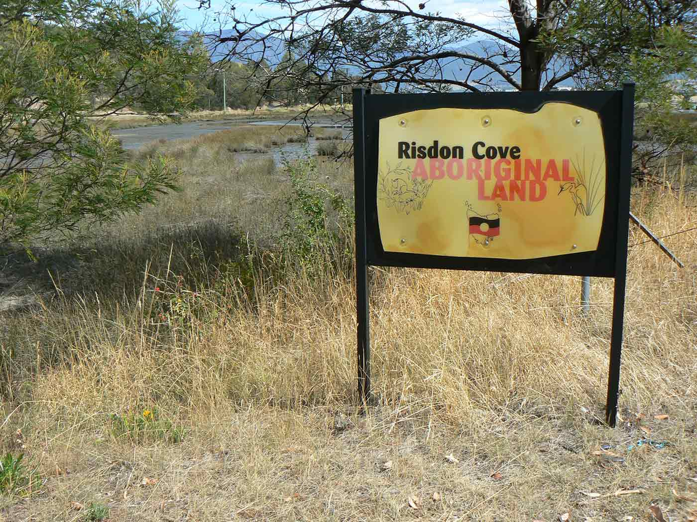 A sign that reads 'Risdon Cove, Aboriginal Land'.