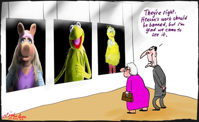 Three images hanging on the wall as if in an art gallery depicting the Sesame Street characters Miss Piggy, Kermit the Frog and Big Bird. An older man and woman peer at them. The man says, 'They're right. Henson's work should be banned, but I'm glad we came to see it.' - click to view larger image
