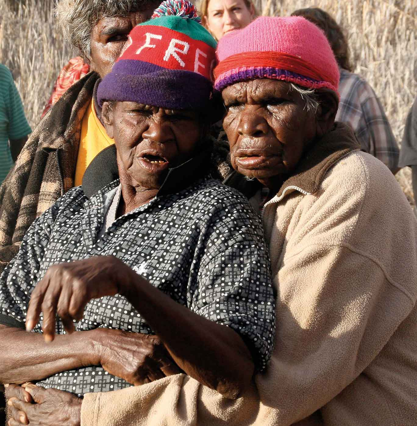 Two elderly women embracing.