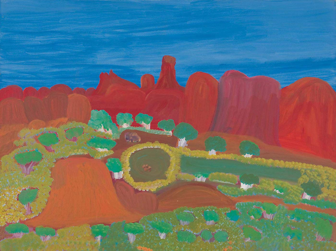 A painting on canvas with a range of orange-red rock formations, including a taller one with a squared top in the centre, against a blue sky in the top section. In the mid ground there are green trees with white trunks and foliage around a circle and rectangle of dark green. In the foreground there is foliage and red ground including an orange red rock-like feature to the left of the painting. - click to view larger image