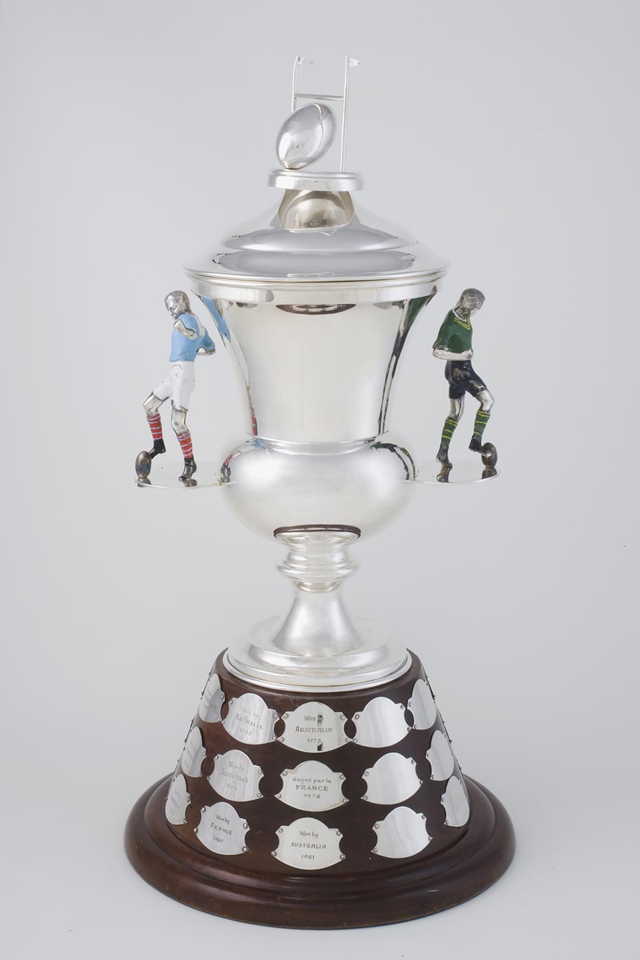 Silver international rugby league trophy with two handles in the form of football players. - click to view larger image