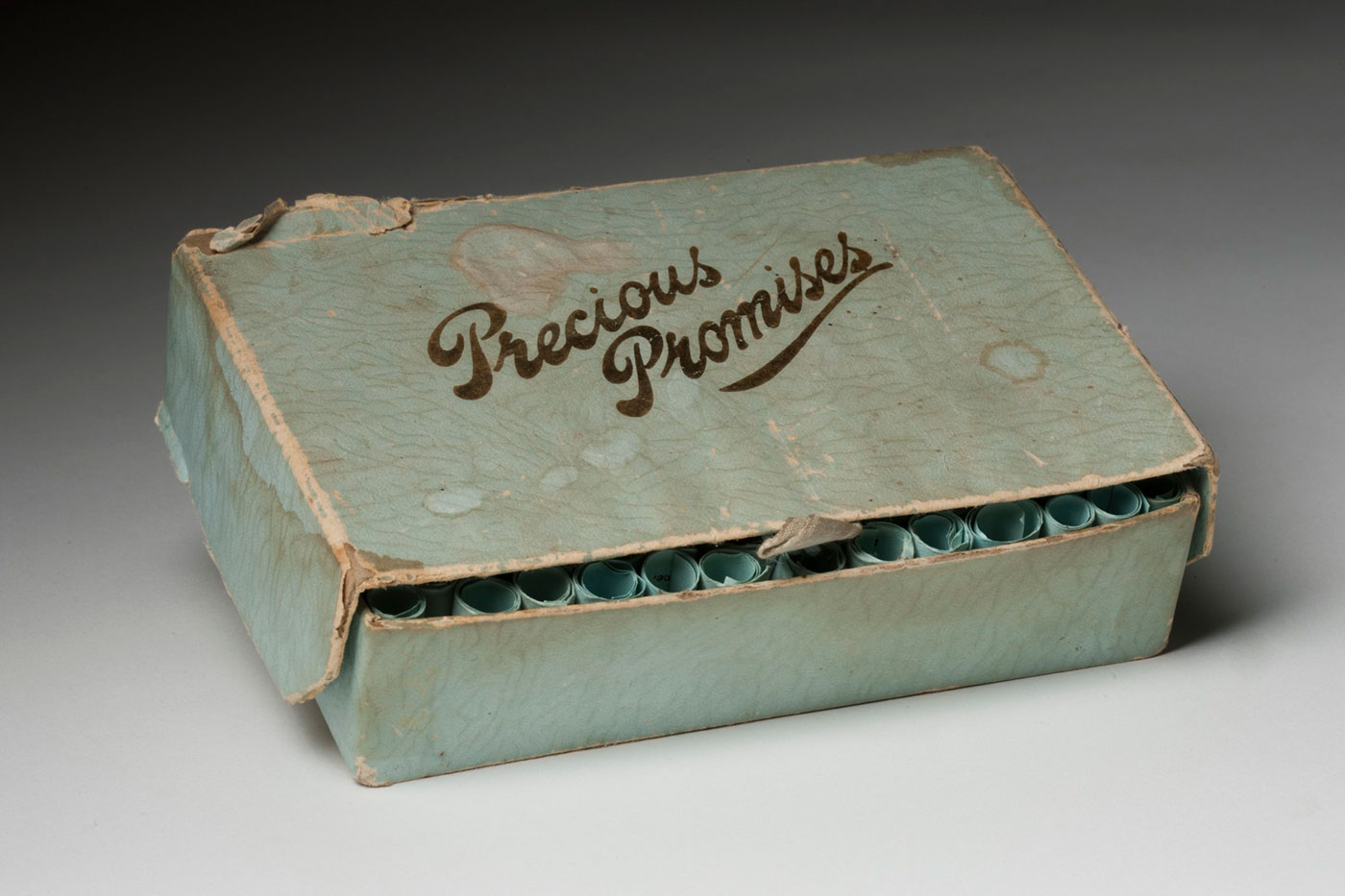 Pale green box with gold trim and hinged lid and the words 'Precious Promises' painted on the lid in gold. - click to view larger image