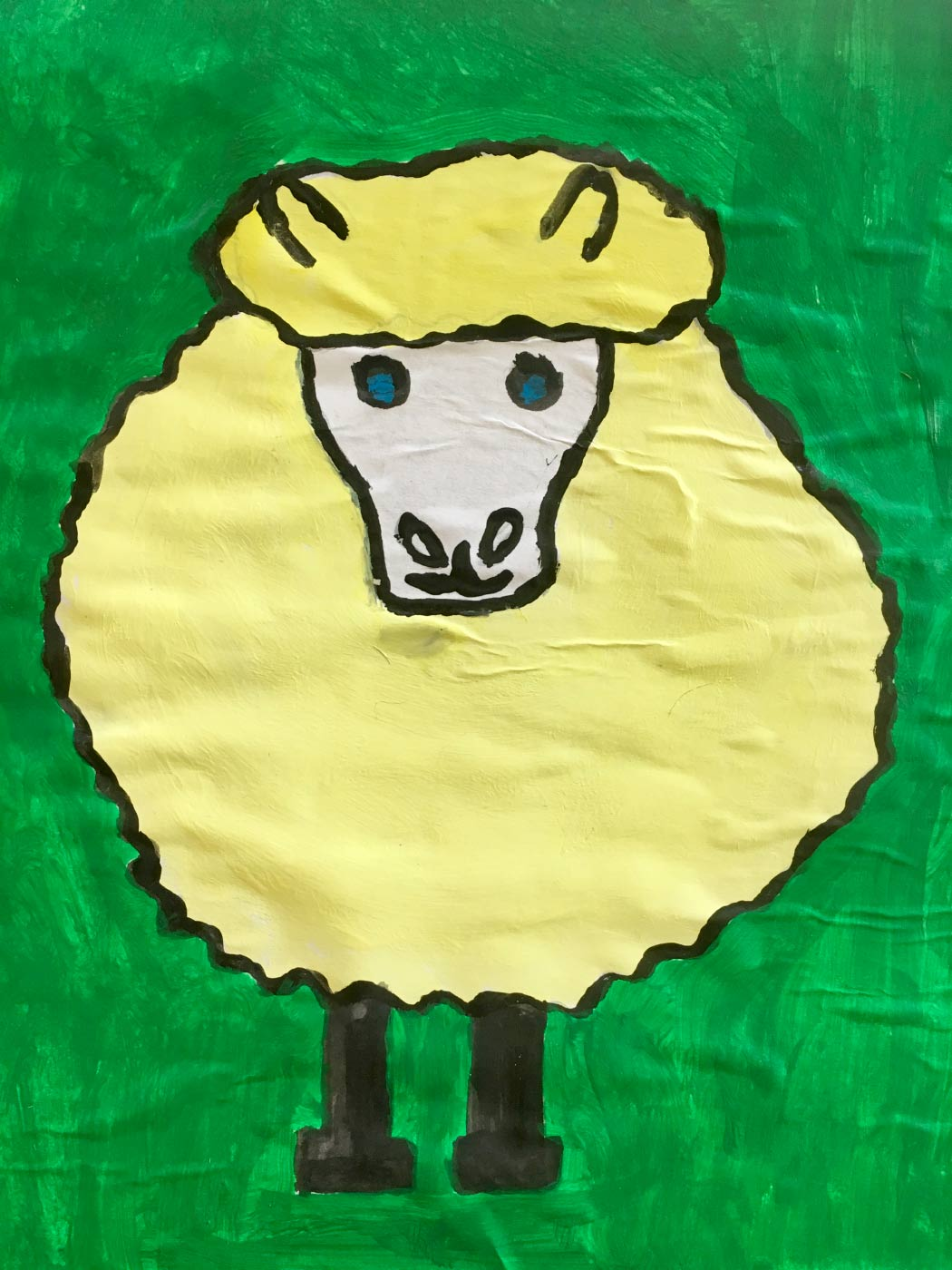 Illustration of a sheep on paper created with textas and paint.