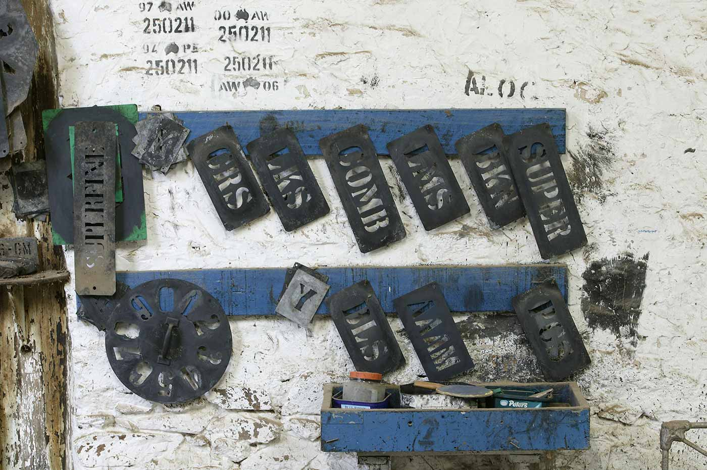 Wool bale stencils hanging on their hooks. - click to view larger image