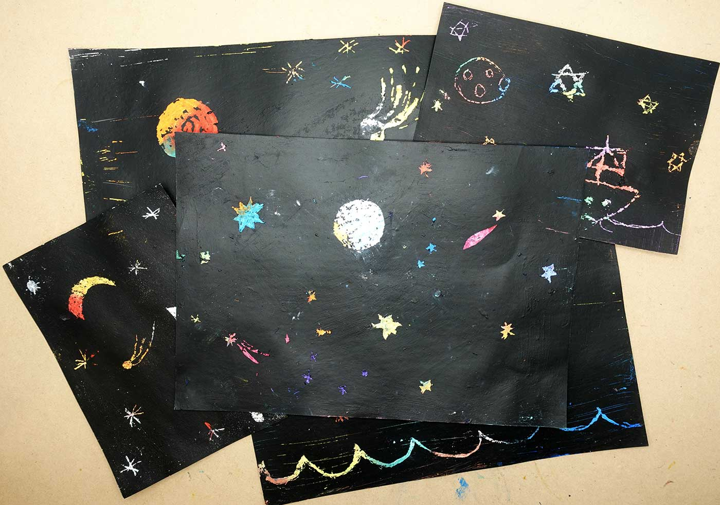 A series of paintings featuring stars and planets in the sky.