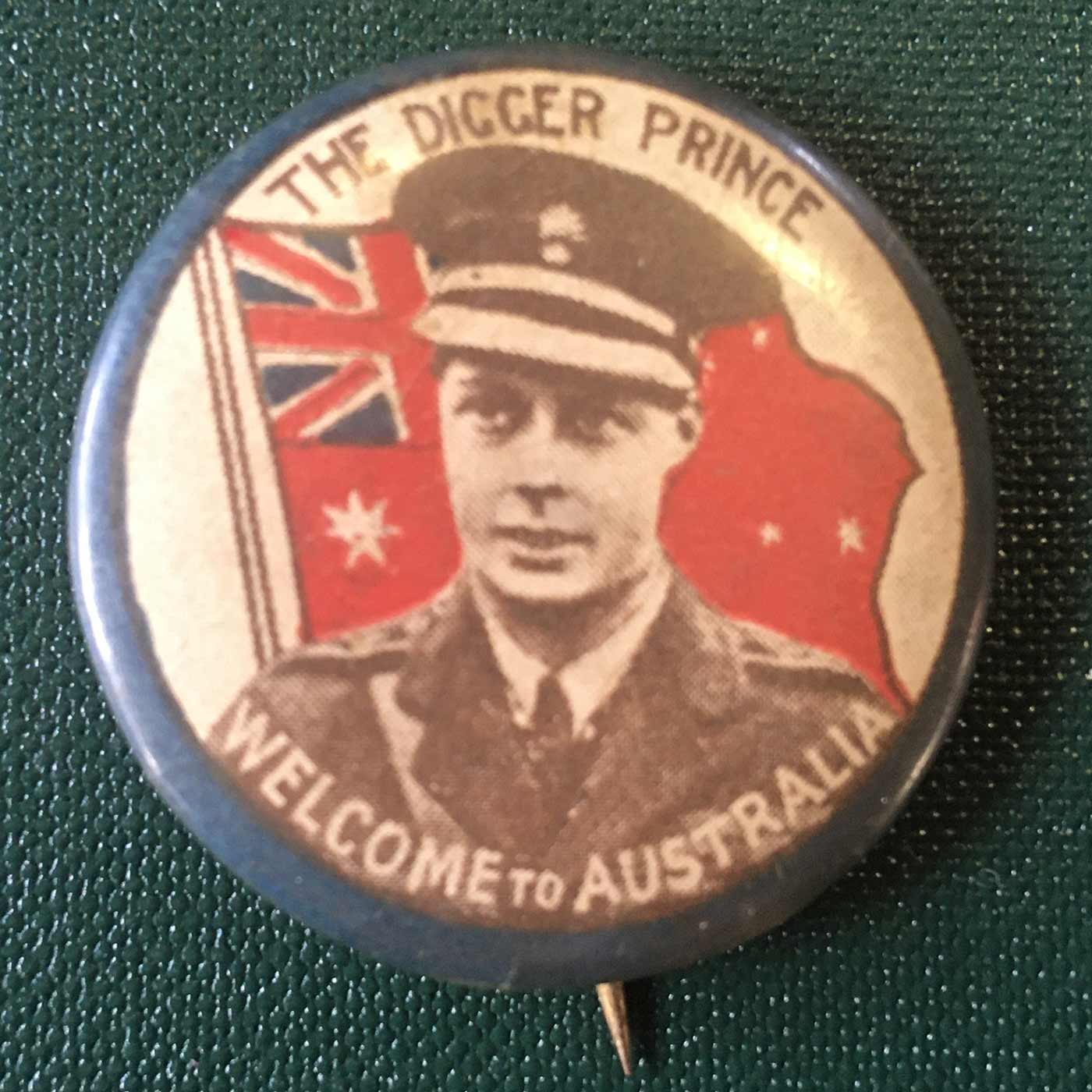Colour photograph of a badge with an illustration of Prince Edward in front of the British flag. There is a label with the text: THE DIGGER PRINCE / WELCOME TO AUSTRALIA. - click to view larger image