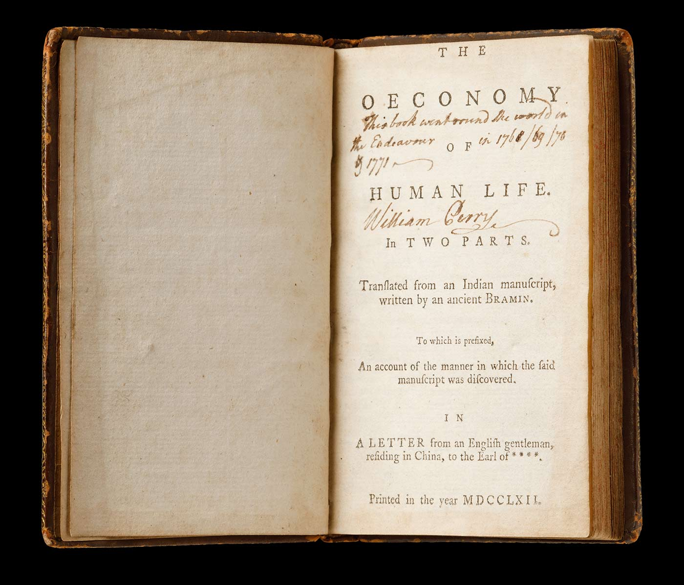 An open book featuring the title 'The Oeconomy of Human Life' on the title page. The title-page has the text [handwritten by William Perry] in black ink that reads 'This book went round the World on the Endeavour in 1768 / 69 / 70 & 1771', with Perry's signature underneath. - click to view larger image