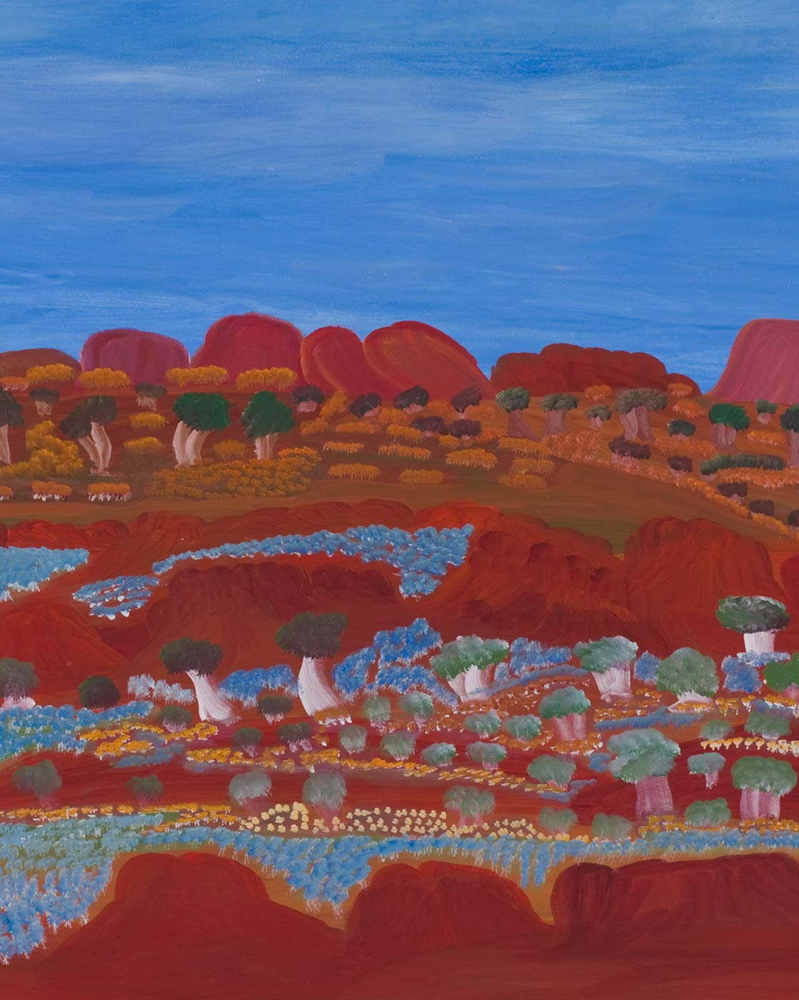 Cropped image of a painting on canvas with a range of orange-red rock formations lying low against a blue sky backdrop. In front of the formations are green and light brown trees and yellow-brown grass-like foliage. In the foreground are two horizontal rows of orange-red rock formations creating a valley-like appearance. The valley and some of the rock formations are covered in expanses of flowers in blue, yellow and cream as well as trees in green and beige-white. - click to view larger image