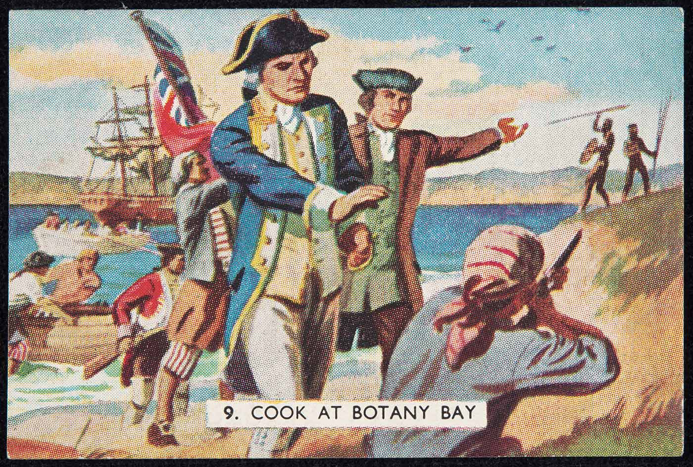 A swap card titled '9. Cook at Botany Bay'. It is from a series of swapcards produced by The Sanitarium Health Food Company titled 'The Story of the Pacific'. The colour picture shows a group of men on the shore in the foreground, one pointing a rifle at two Indigenous men with spears in the background. Captain Cook is shown with his hand raised as if to halt the actions of the man with the rifle. - click to view larger image