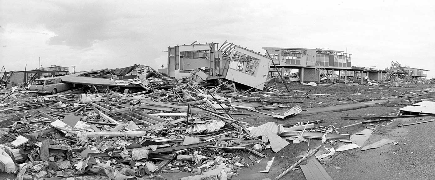Black and white photograph of destroyed buildings.
