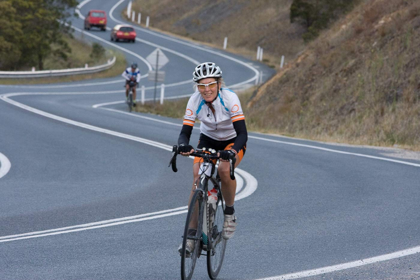 Gaye Bourke riding a bicycle. - click to view larger image