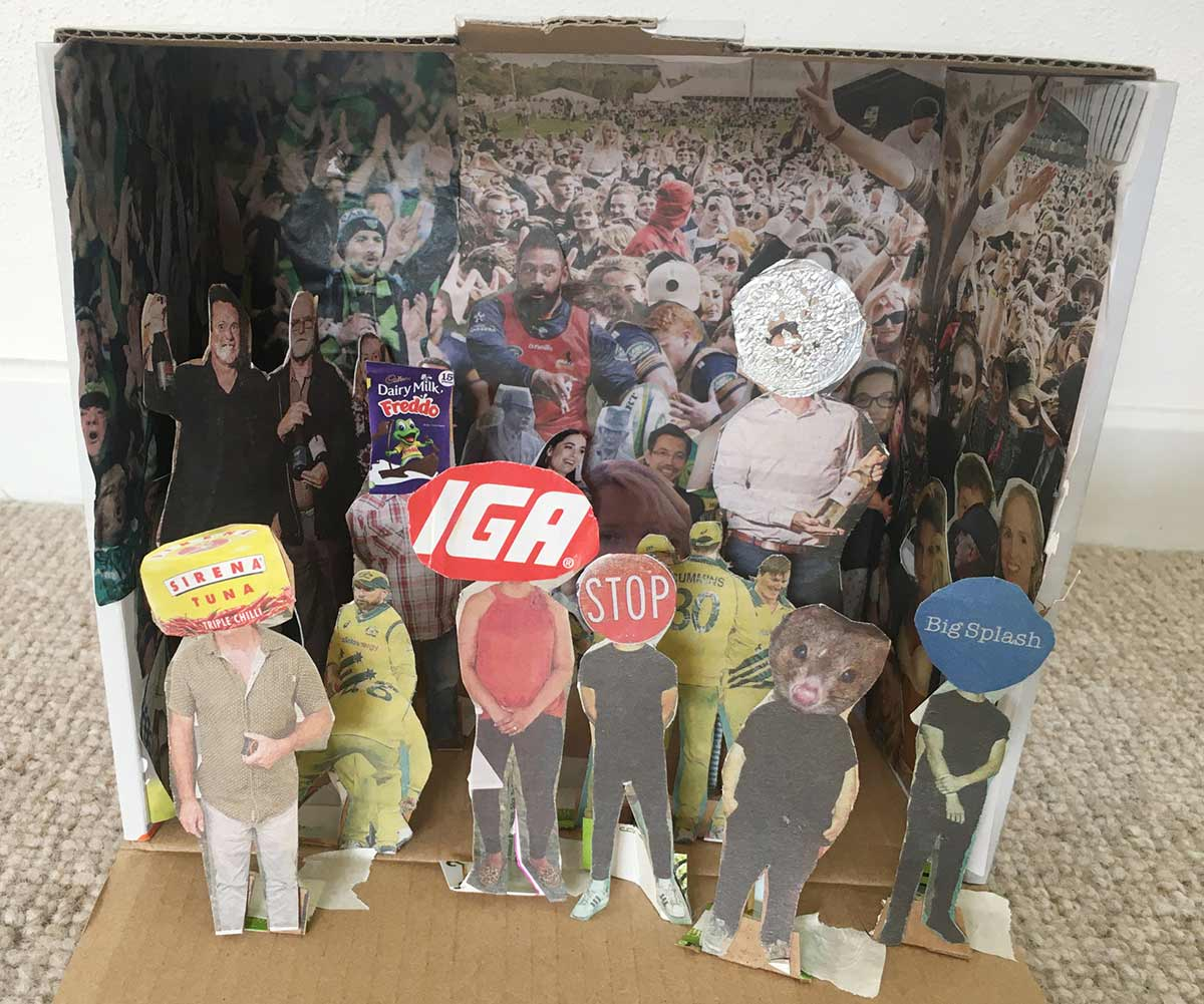 A cardboard box revealing an interior featuring various cut out shapes from publications and various other objects of celebrities, sports teams, crowds of people and product labels. - click to view larger image