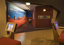 Computer screens and the entry of the Goolarri radio studio in the Gallery of First Australians.