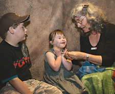 Storyteller Rose Costelloe entertaining young Museum visitors Darcy and Neave.