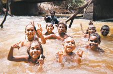 Photo of the Amangul mob from Adelaide River School in the Northern Territory cooling off in the local creek, taken by a student photographer for the Snapshots website.